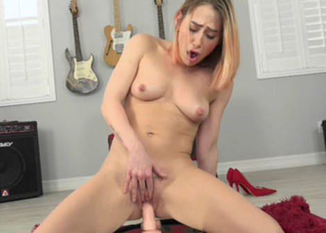 Carter Cruise takes a ride on her dildo